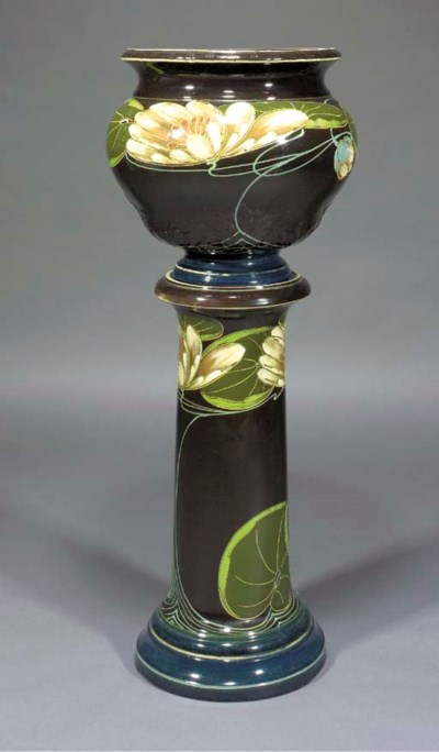 AN EARTHENWARE JARDINIERE AND