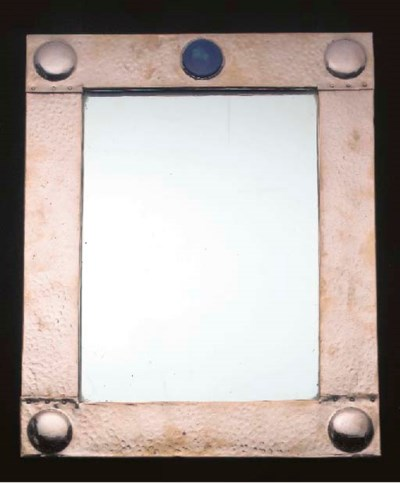 A HAMMERED COPPER WALL MIRROR