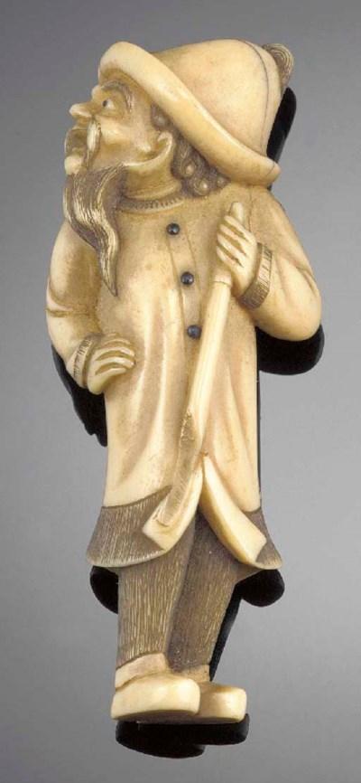 An ivory netsuke of a bearded