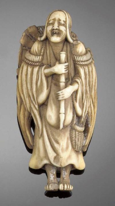 An ivory netsuke of a priest E
