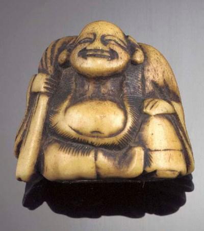 A staghorn netsuke of Hotei 18