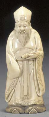 An ivory okimono of a bearded