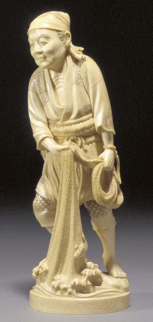 A large ivory okimono of a fis