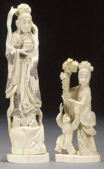 An ivory okimono of a deity 19