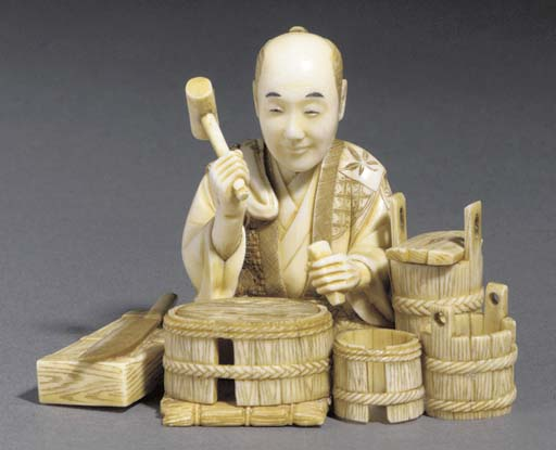 An ivory okimono of a basket m