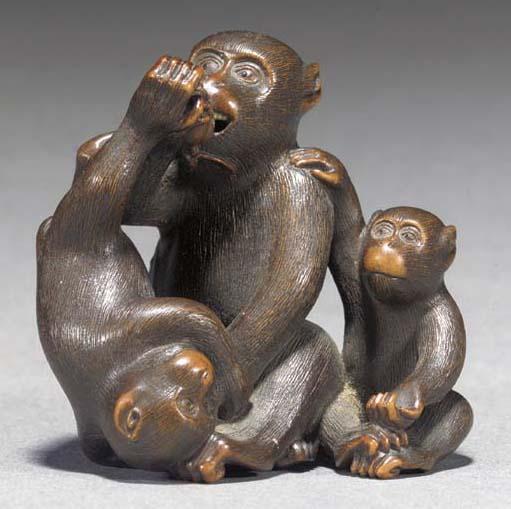A wood okimono of three monkey