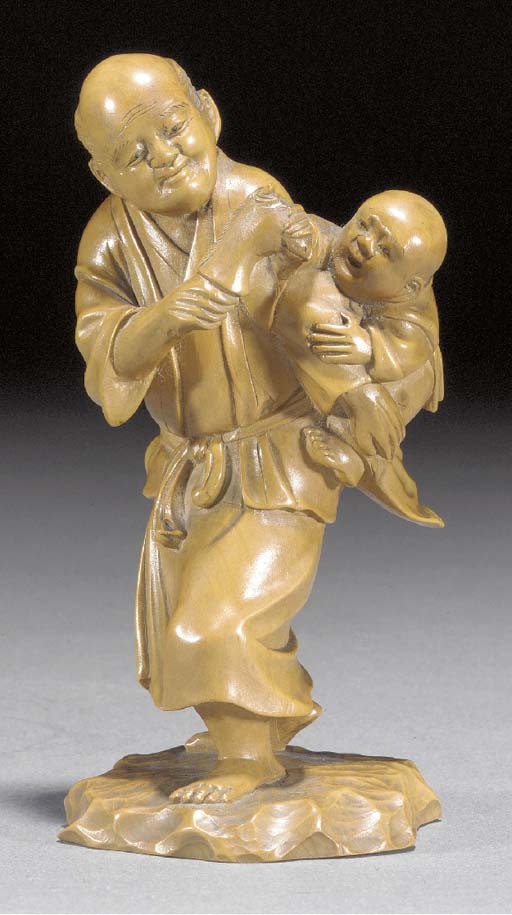 A wood okimono of two figures
