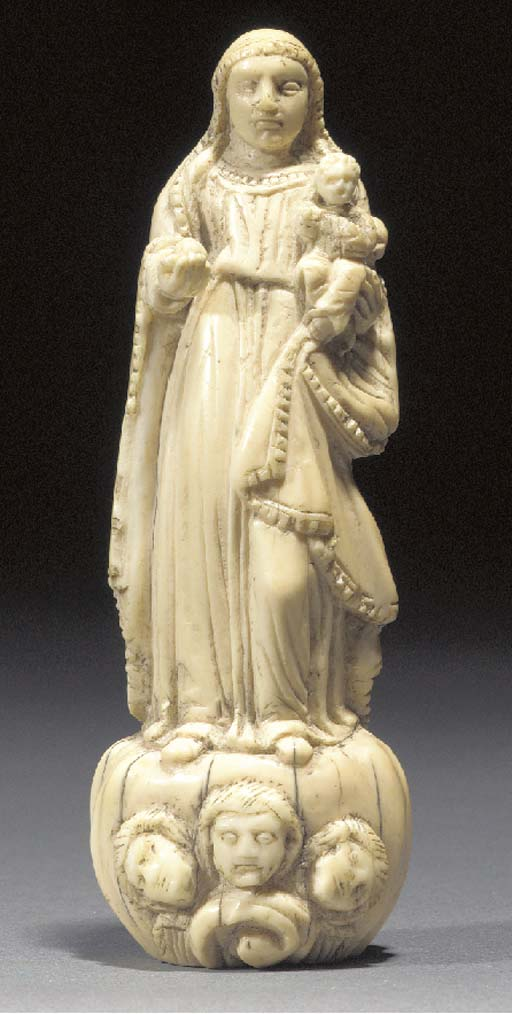 A Goanese ivory mother and chi
