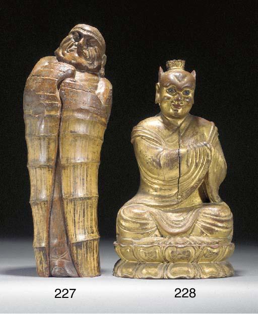 A Japanese bamboo figural carv