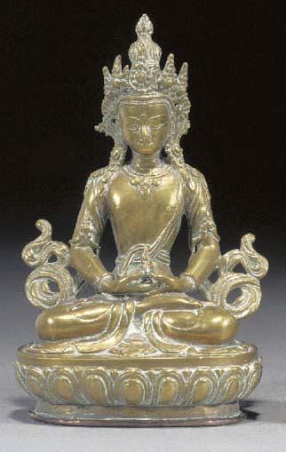A Tibetan gilt bronze seated d
