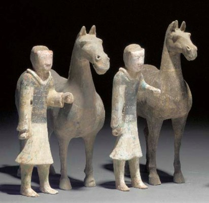 A pair of Han grey pottery hor