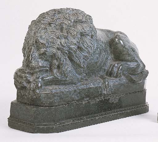 An Italian sculpted green serpentine marble model of a recumbent lion