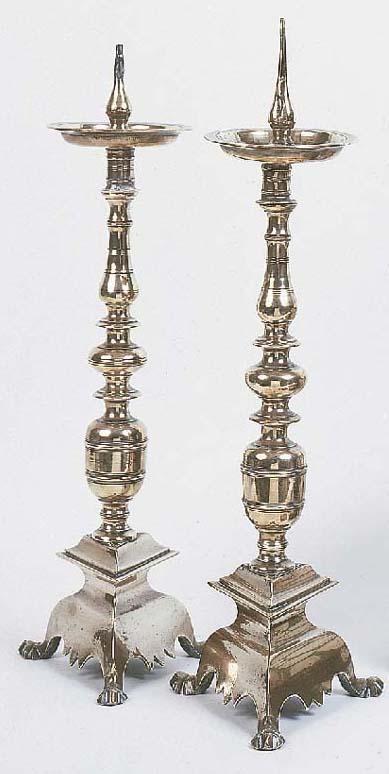A pair of brass altar pricket