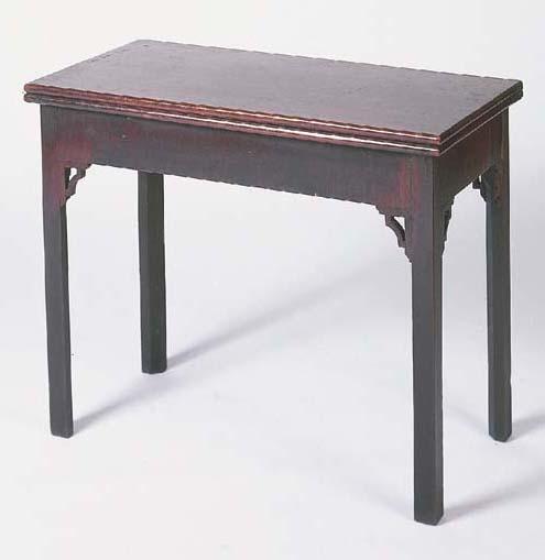 A George II mahogany concertina-action card table