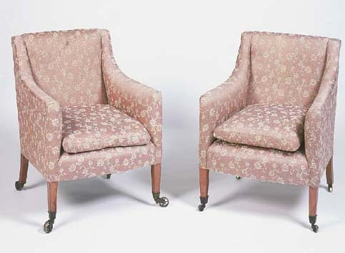 A pair of late George III mahogany armchairs