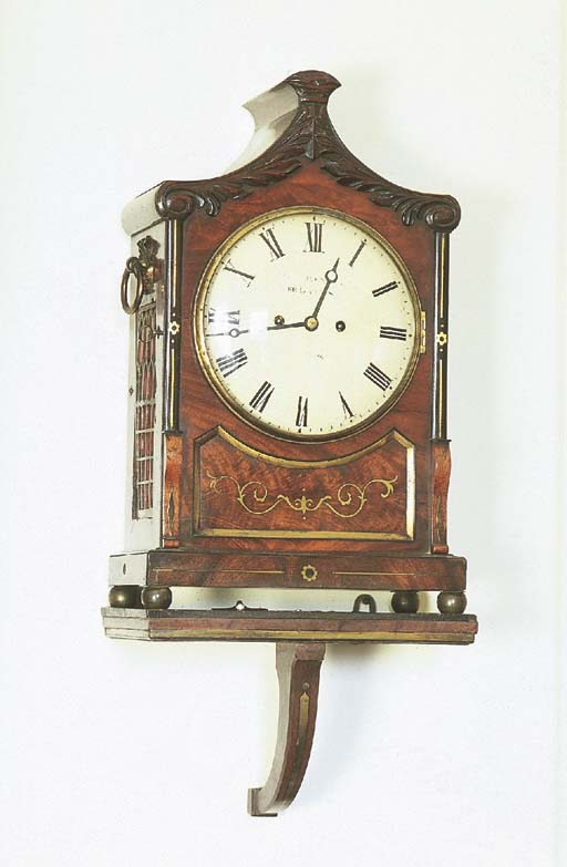 A William IV mahogany and brass-inlaid striking bracket clock