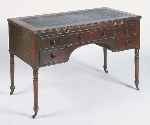 A George IV mahogany centre writing table