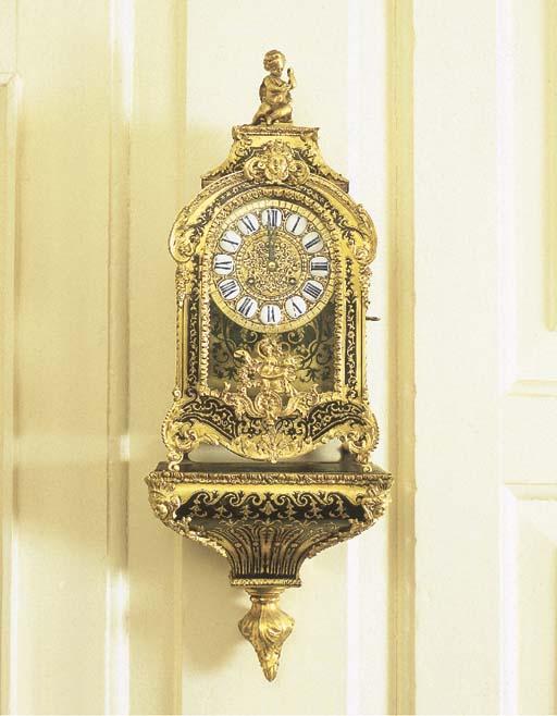 A French brass inlaid mock tortoiseshell small striking bracket clock with wall bracket