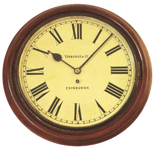 A mahogany dial clock