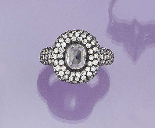 A diamond cluster ring with bl