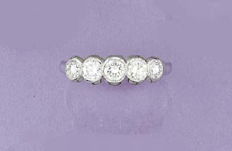 A diamond five stone half-hoop