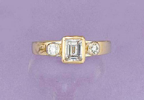 A step-cut diamond single ston