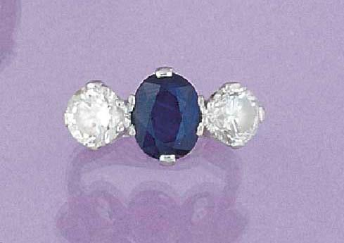 A platinum, sapphire and diamo