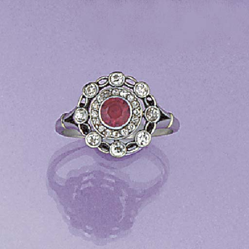 A ruby and diamond circular cl