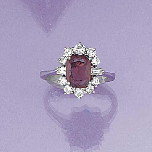 A ruby and diamond oval cluste