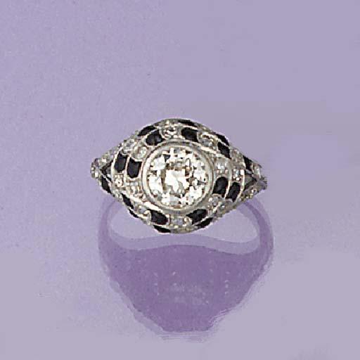 A diamond and calibré onyx rin