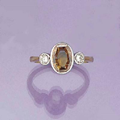 A brown diamond and diamond ri
