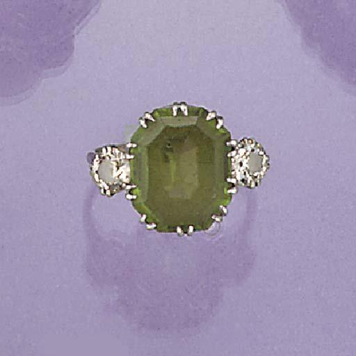 A peridot and diamond three st