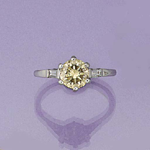 A tinted diamond single stone ring with baguette diamond single stone shoulders,