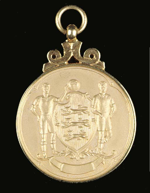 A 9ct gold medal, the reverse