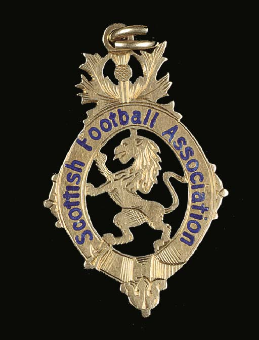 A 14ct gold and enamel medal,