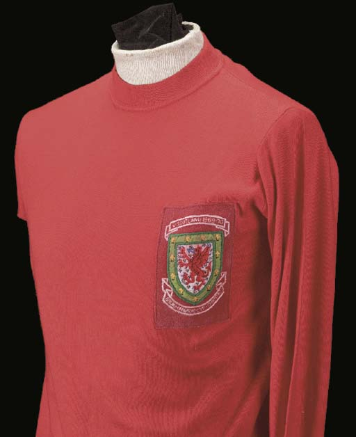 A red Wales International shirt, No.5, with crew-neck collar and embroidered cloth badge, inscribed V. Scotland, 1969-70