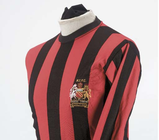 A red and black 1969 Mancheste