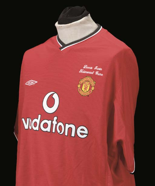 A red Manchester United Dennis