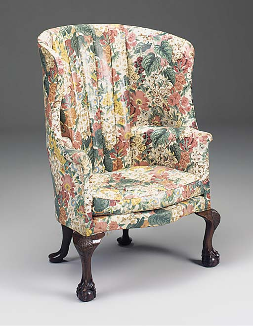 A MAHOGANY WING ARMCHAIR, 19TH CENTURY IN THE GEORGIAN STYLE