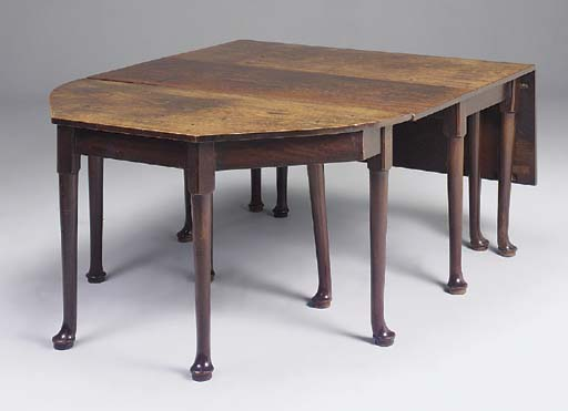 A MAHOGANY DINING TABLE IN TWO PARTS, GEORGIAN WITH ALTERATIONS AND RECONSTRUCTION