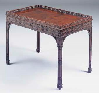 A CARVED MAHOGANY SILVER TABLE