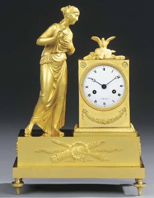 An Empire ormolu striking mantel clock