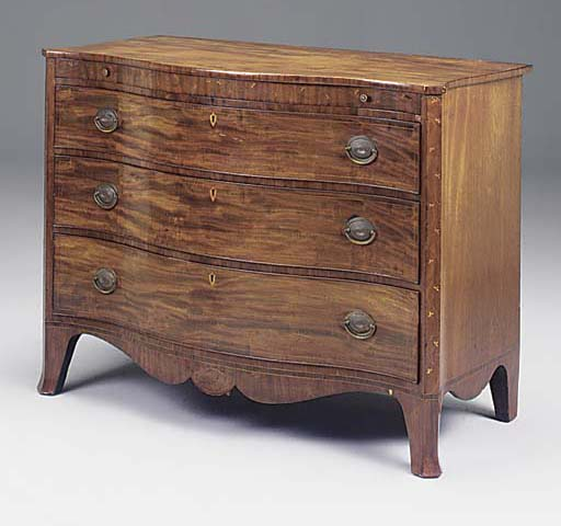 A LATE GEORGE III MAHOGANY AND INLAID SERPENTINE CHEST