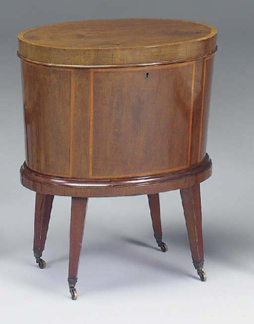 A MAHOGANY SATINWOOD CROSSBANDED AND INLAID OVAL CELLERETTE, 19TH CENTURY