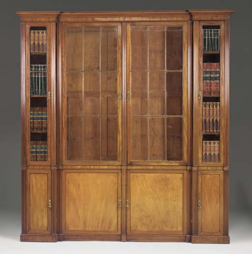 A MAHOGANY LIBRARY BOOKCASE OF RECESSED BREAKFRONT OUTLINE, PART GEORGIAN