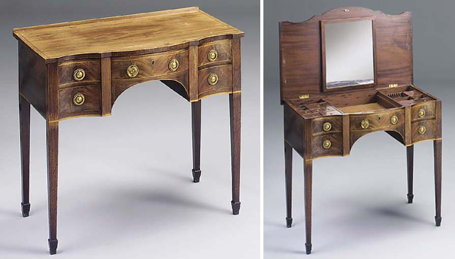 A GEORGE III MAHOGANY SERPENTINE AND INLAID DRESSING TABLE