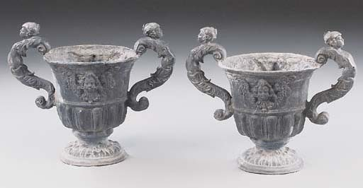 A pair of English lead garden urns, early 20th century
