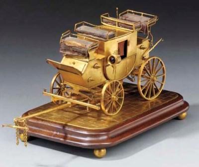 A Victorian gilt brass desk st