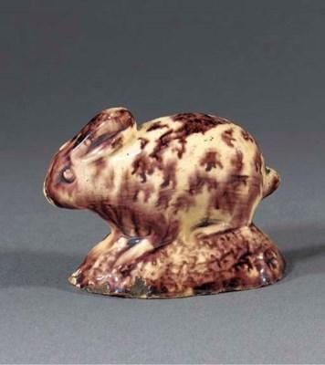 A creamware model of a crouchi