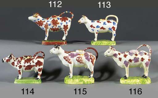 A pearlware cow-creamer and a